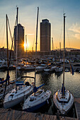 Boats in seaport at sunset, Barcelona