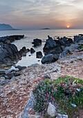 Coastline in the spring afternoon. Sferracavallo, Sicily. Italy.