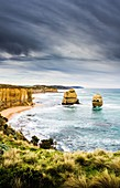 Panoramic view from Port Campbell National Park lookout towards 2 apostles during a stormy day. Australian natural wonders.