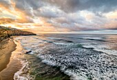 View of North Garbage Beach and the Pacific Ocean in the early morning. Sunset Cliffs Natural Park, San Diego, California, United States.
