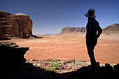Silhouette of a woman and red sand desert in Jebel Khazali area. Jordan, Wadi Rum desert, protected area inscribed on UNESCO World Heritage list. Model Released.