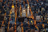 Aerial View Flatiron District - Some of the skyscrapers and buildings seen are the New York Life Insurance Co. , Flatiron, Met Life Insurance Co. as well as Madison Square Park. Aome of the illuminated streets in Manhattan are 5th and Madison Avenue in Ne