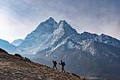 Trekkers climb a small peak above Dingboche in the Everest region in time to see the sunrise, with Ama Dablam in the distance, Himalayas, Nepal, Asia