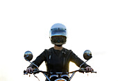 Centered perspective of a woman sitting on her vintage motorcycle wearing a reflective helmut face shield with a clean white background