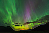 The aurora borealis fills the sky over the Chugach and Kenai Mountains, Southcentral Alaska