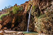 'Water flowing out of a rock cliff; Israel'