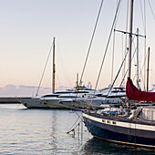'A row of yachts moored in a harbour; Ischia, Italy'
