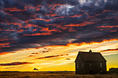 'Abandoned house in rural Iceland with a brilliant sunset; Iceland'