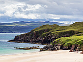 'White sand and rugged cliffs along the coastline of the Highlands; Scotland'