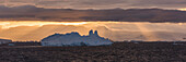 'Jagged iceberg in silhouette against dawn sky; Antarctica'
