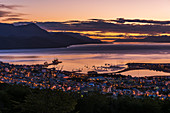 'Orange and purple pre-dawn light over Ushuaia; Ushuaia, Antarctica'