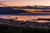'Orange and purple pre-dawn light over Ushuaia; Ushuaia, Antarctica'