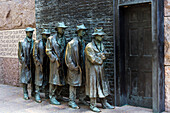 'Bronze statue depicting people waiting on a bread line during the Great Depression, Franklin Delano Roosevelt Memorial; Washington, District of Columbia, United States of America'