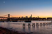 'Sunset over Lower Manhattan near World Trade Center and Williamsberg Bridge; Brooklyn, New York, United States of America'