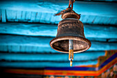 'A old brass bell hangs in a Tibetan monastery; Ladakh, India'