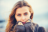Fashion lifestyle, Portrait of beautiful girl close-up with amazing eyes. Woman on the beach at sunset.