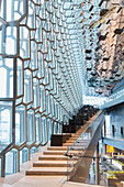 'Stairs in the interior of the Harpa Public Concert Hall, designed by the Danish firm Henning Larsen Architects and the Icelandic firm Batteriao Architects, the glass facade designed by Icelandic glass artist Olafur Eliasson; Reykjavik, Iceland'