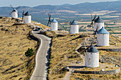 'Windmills in a row along a road; Consuegra, Spain'