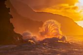 'Surf crashes on the Na Pali coast at sunset; Kauai, Hawaii, United States of America'