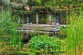'Pergola and lily pond in Leo Mol Sculpture Garden of Assiniboine Park; Winnipeg, Manitoba, Canada'