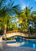 'Swimming pool and footbridge at a resort on the Caribbean; Playa del Carmen, Quintana Roo, Mexico'
