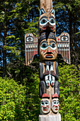 Native Alaskan totem pole on a sunny day, Totem Bight State Historical Park, Ketchikan, Southeast Alaska, USA