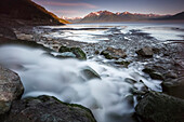 View of Rainbow Creek where it enters Turnagain Arm with the Kenai Mountains in the background, Southcentral Alaska, summer