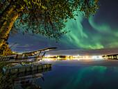 Northern Lights (Aurora Borealis) light up the sky over Lake Hood, Anchorage, Southcentral Alaska
