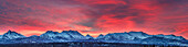 Panorama view of a winter sunrise over the Chugach Mountains in south Anchorage, Southcentral Alaska