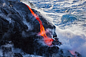 'The Pahoehoe lava flowing from Kilauea has reached the Pacific ocean near Kalapana; Island of Hawaii, Hawaii, United States of America'