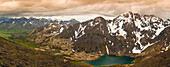 A panoramic view of Skip Lake and valley from Ship Pass in the Chugach State Park near Anchorage, Southcentral Alaska, summer