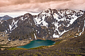 Scenic view of Skip Lake and valley from Ship Pass in the Chugach State Park near Anchorage, Southcentral Alaska, summer