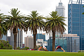Yoga session in Kings Park, with the skyline of Perth as the background