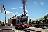 historical steam train close to Benedictine abbey at the so called Haertsfeld, Neresheim, Ostalb district, Swabian Alb, Baden-Wuerttemberg, Germany