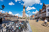 The Nieuwe Kerk, new church at the marketplace with the typical accumulation of bicycles, Delft, the Netherlands