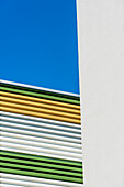 Coloured horizontal stripes as a covering at a car park radiating a graphic effect, Hamburg, Harburg, Germany