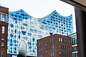 View of the unique facade of the concert hall Elbphilharmonie with the surrounding office houses, Hamburg, Hafencity, Germany