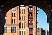View at the warehouse district Speicherstadt from the inner courtyard of an old office house, Hamburg, Germany