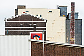 Portrait of a man on an advertisement on buildings in the harbour and industrial zone, Rotterdam, Netherlands