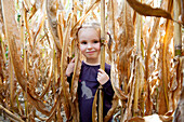 Little girl in cornfield, portrait