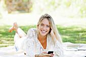 Woman using smartphone, portrait