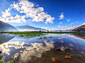 Panoramic view of Pian di Spagna flooded with Mount Legnone reflected in the water Valtellina Lombardy Italy Europe
