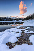 Woods and snowy peaks are reflected in Pal?? Lake at sunrise Malenco Valley Valtellina Lombardy Italy Europe