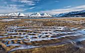 The icy sandy beach surrounding the snow capped mountains Breivikeidet Lyngen Alps Troms?© Lapland Norway Europe