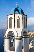 The blue dome of the church dominates the Aegean Sea Santorini Cyclades Greece Europe