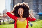 Smiling Black woman posing at waterfront