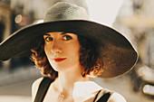 Caucasian woman wearing sun hat