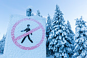 Iced sign no crossing, crystals, in a winter landscape, forest, fir trees covered with snow, mountains, dusk, winter sport, Ski area, Harz, MR, Sankt Andreasberg, Lower Saxony, Germany
