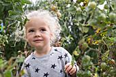 Little girl in vegetable garden