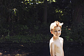 Bare-chested boy, portrait